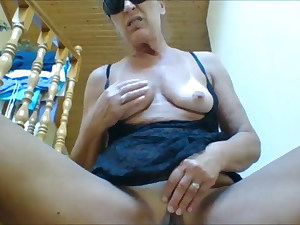 Mature with big melons masturbates on the floor